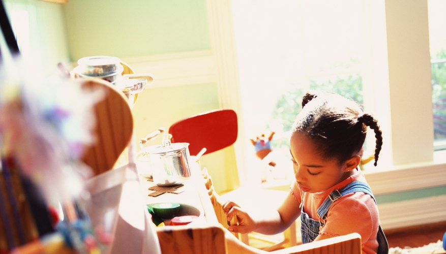 Young children enjoy pretending with realistic props.