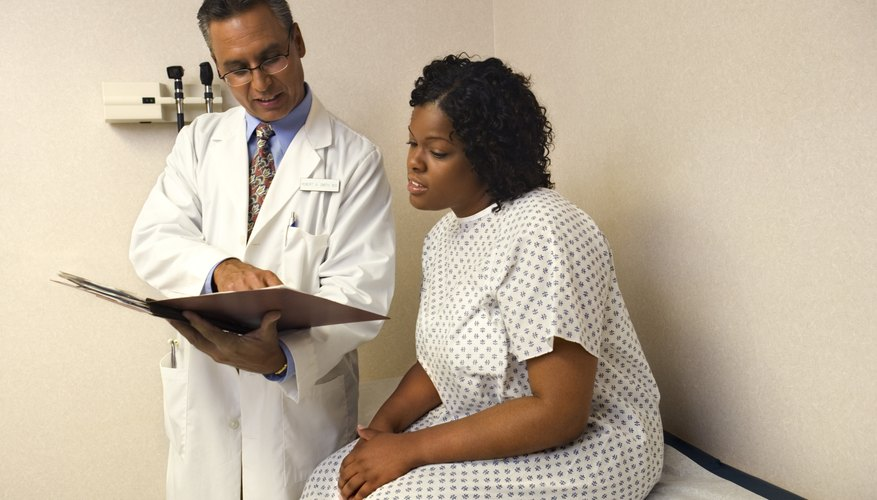 Doctor looking at chart with patient