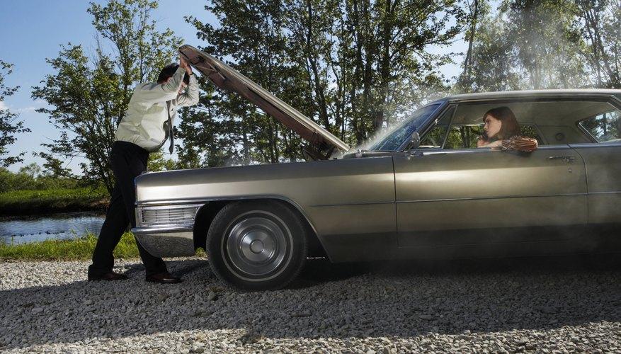Woman in car, man looking under hood, side view