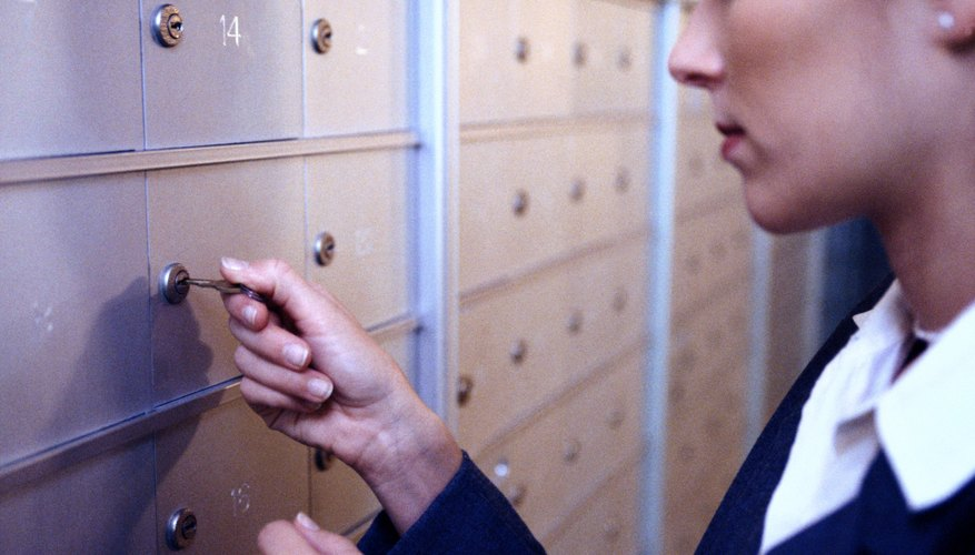 A woman is opening her post office box.