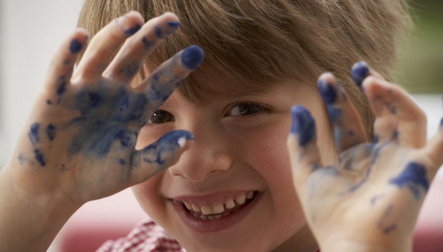Finger painting is a go-to toddler activity.