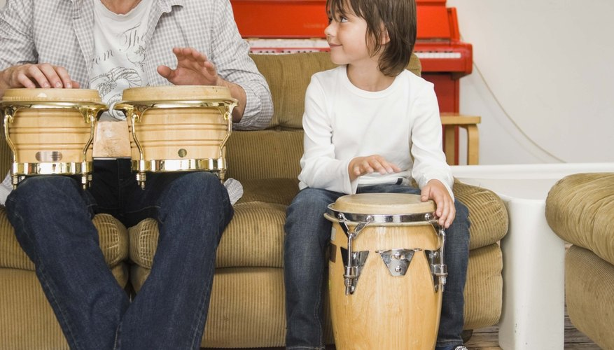 Father and son playing congas