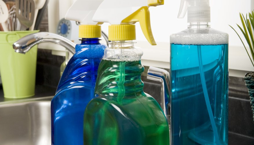 Bottles of spray cleaners on kitchen counter