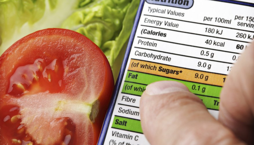 A man reads the nutritional label of a package.
