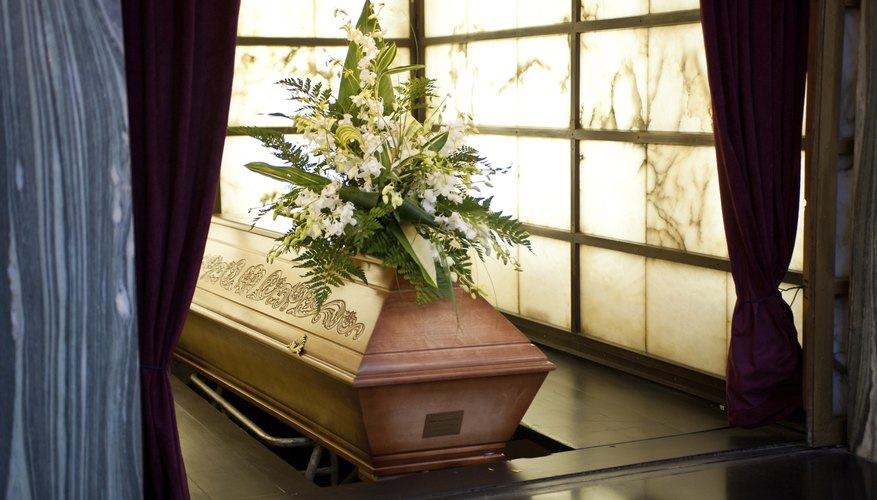 Coffin with flowers.