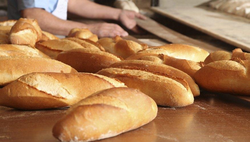 A baker makes fresh bread.