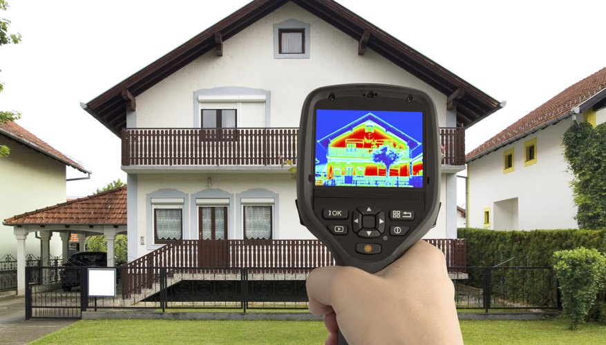 Warm spots on a house, revealed by an infrared camera, can indicate poor thermal insulation.