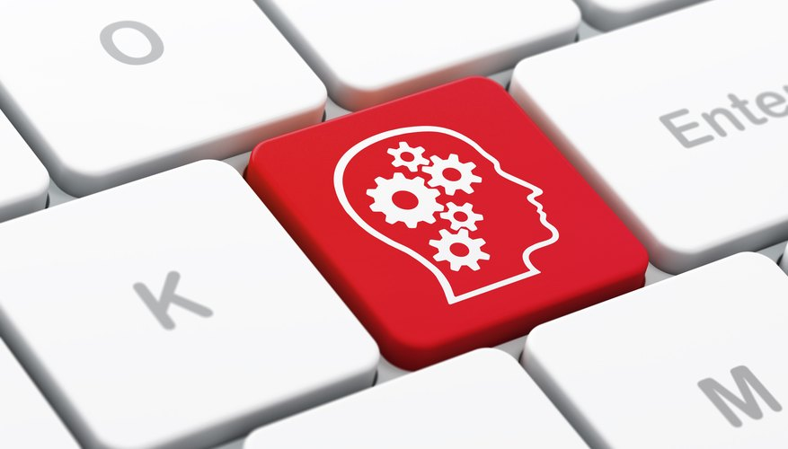 Advertising concept: Head With Gears on computer keyboard background