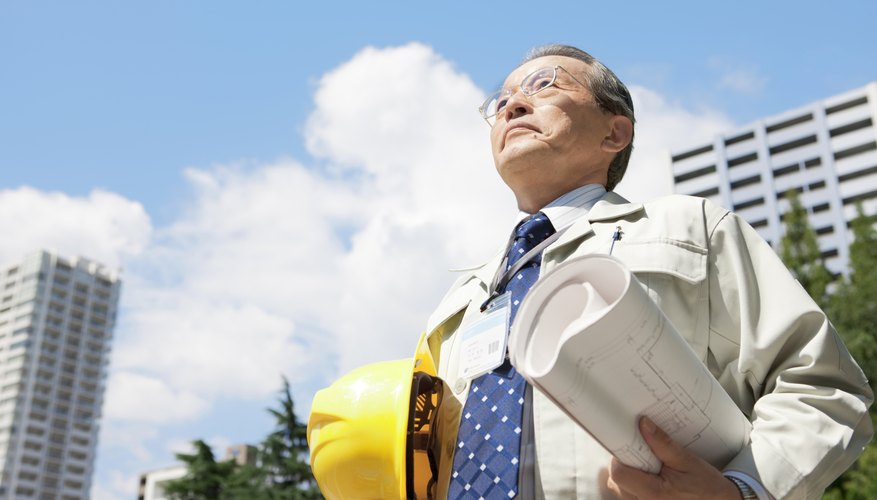 Mature Man Holding Blueprint and Hardhat