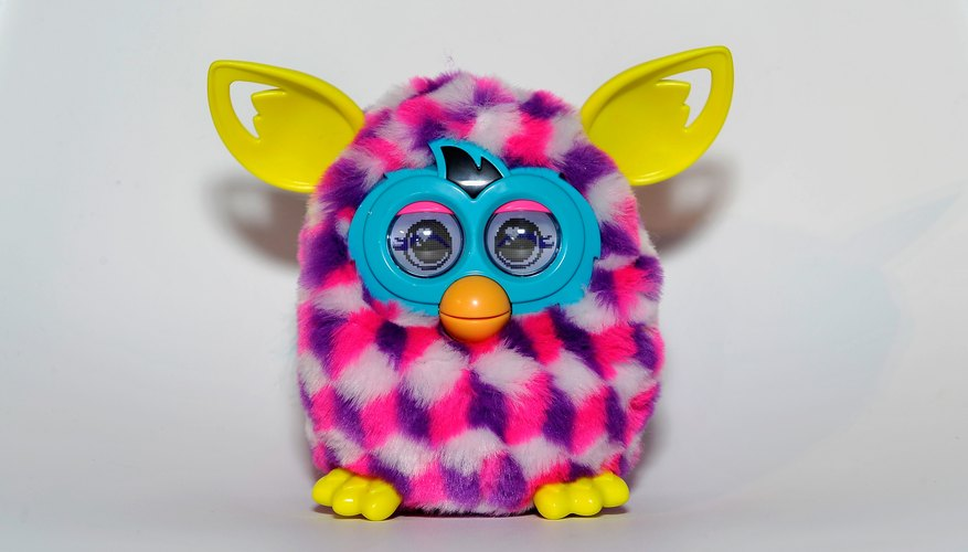 A furby on a white studio background.
