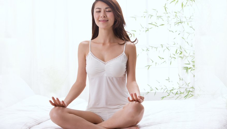 A woman meditates in the morning.