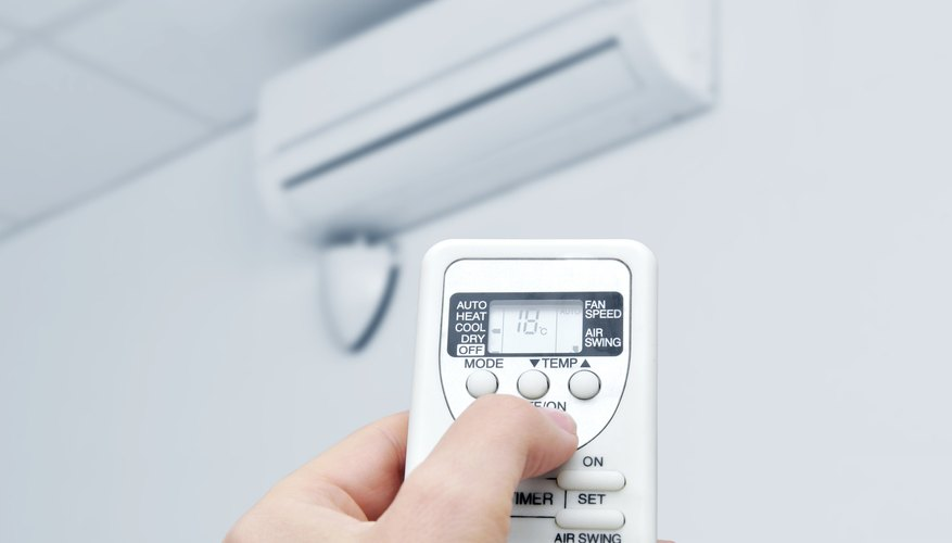 Remote controlled air conditioner removes humidity by drying ambient air