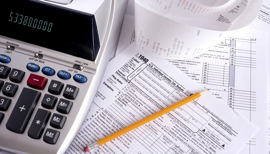 Calculator on top of tax papers