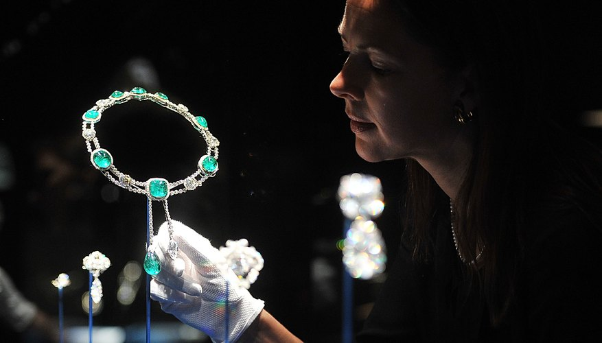 Royal emerald and diamond jewelry on display