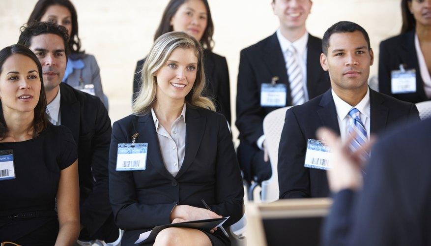 Delegates Listening To Speaker At Conference