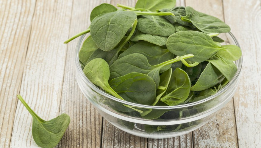 Glass bowl filled with baby spinach