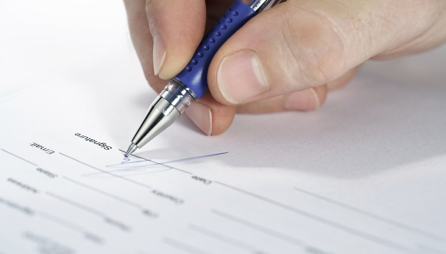 Image of a man signing a mortgage document.