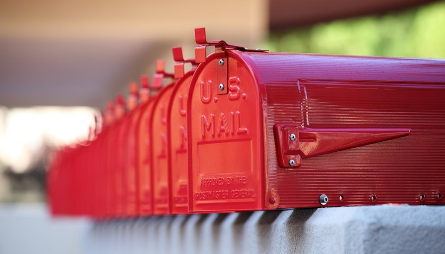 us glossy red mailbox repetition and blurred background