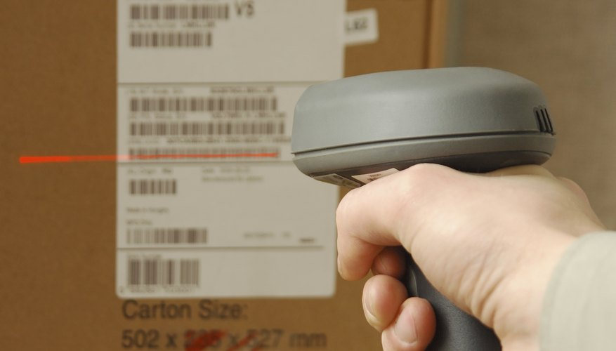Barcode scaner in hands for a man