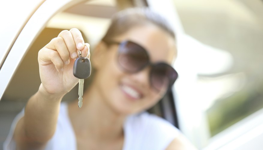 woman driver happy sit with car keys in hands