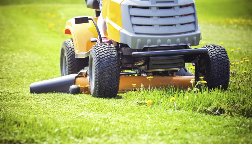 Close-up of a lawn tractor mowing grass