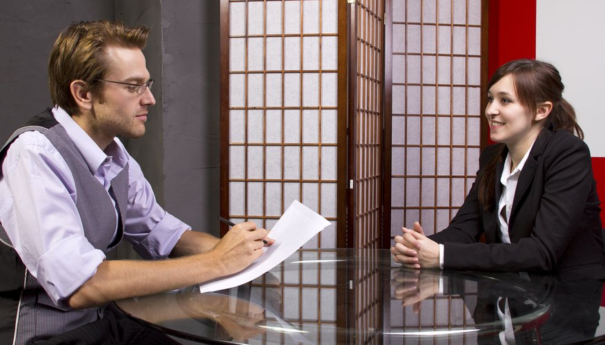 Manager reviewing performance of pleased workers job