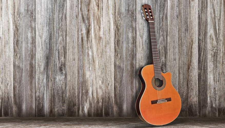 Classical guitars have wider necks than acoustic guitars