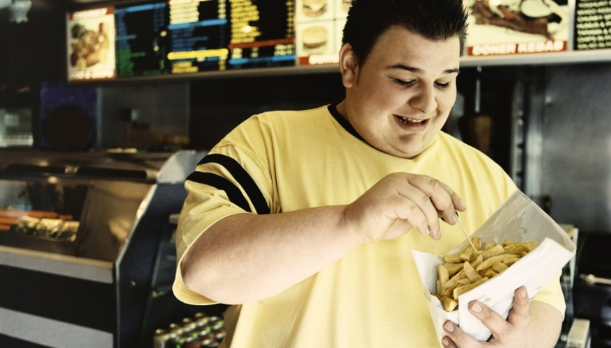 Processed foods from fast food restaurants may contribute to a teenager's weight gain.