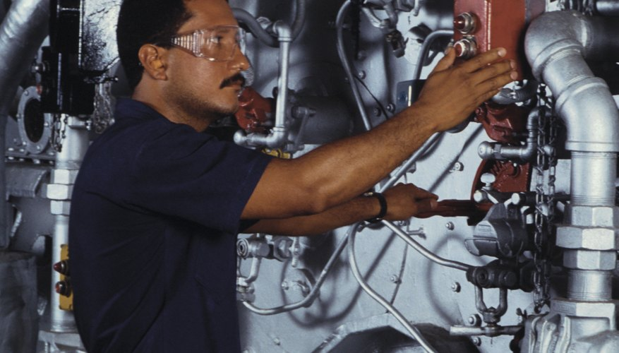 Employee in compressor room adjusting controls
