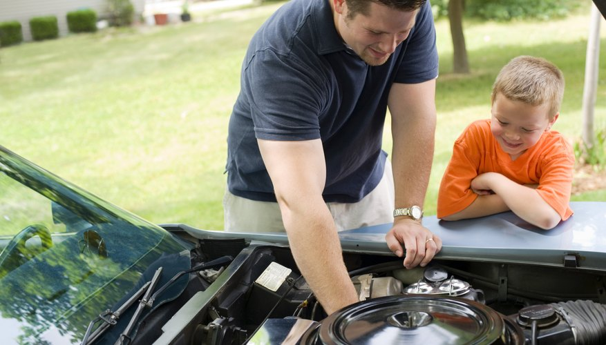 Father and son repairing car