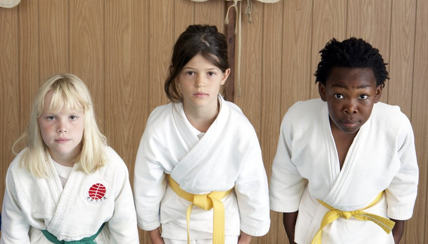 Add to your child's experience and join her karate class.