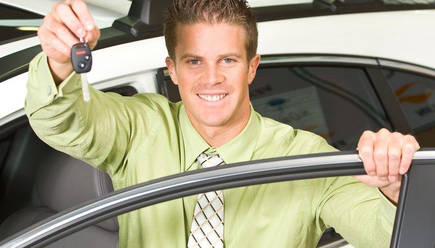 Car salesman posing with keys