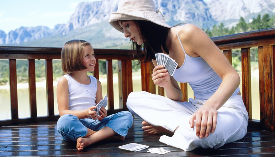 Playing cards and other games teaches kids about rules and taking turns.