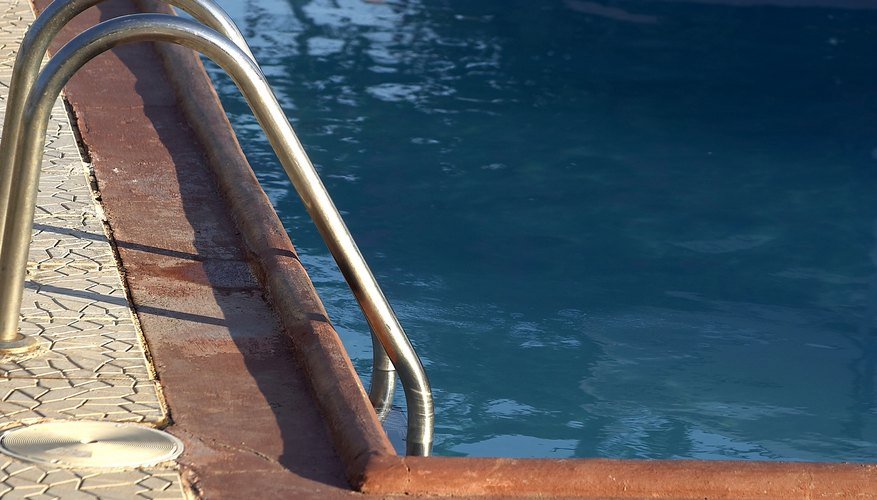 The average cost of an inground pool is affected by options such as an access ladder.