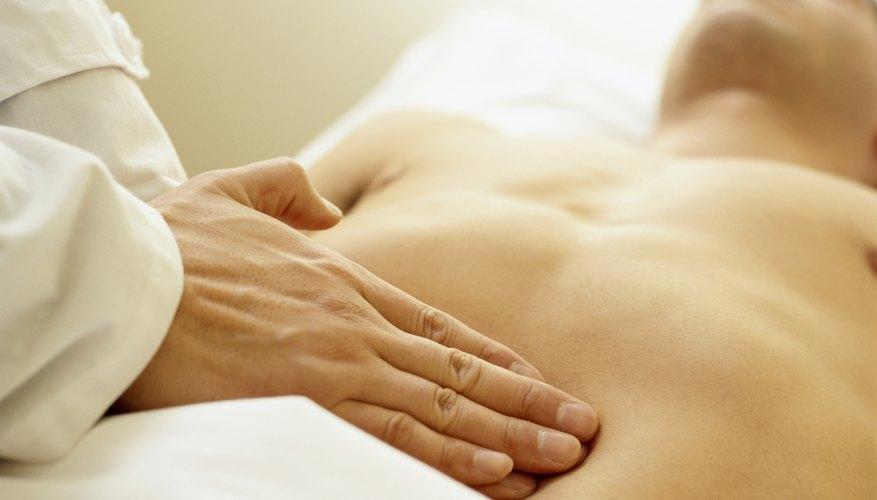Doctor touching patients abdomen