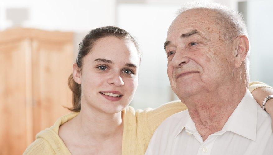 Young woman hugging senior man, portrait