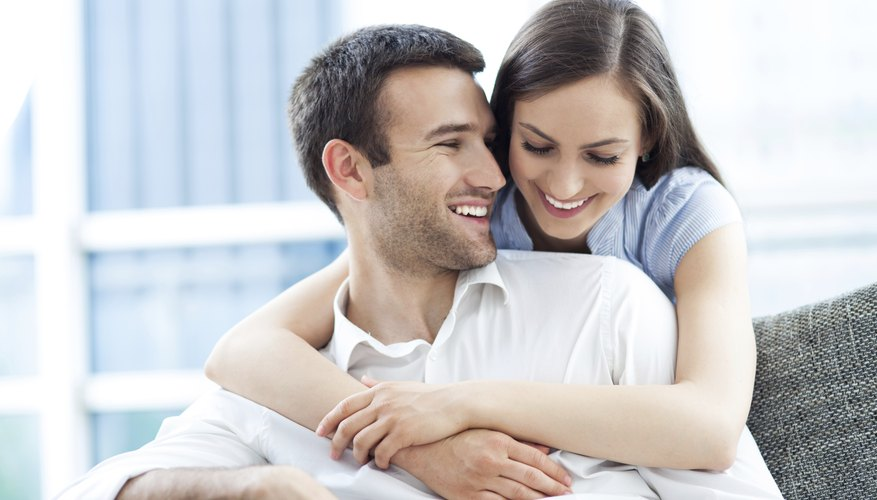 Smiling newlywed couple in apartment