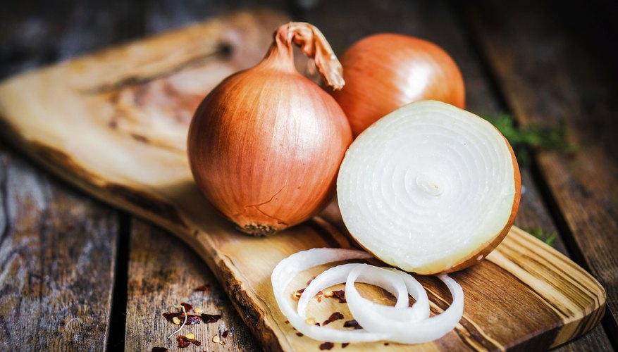 Onions on a cutting board.