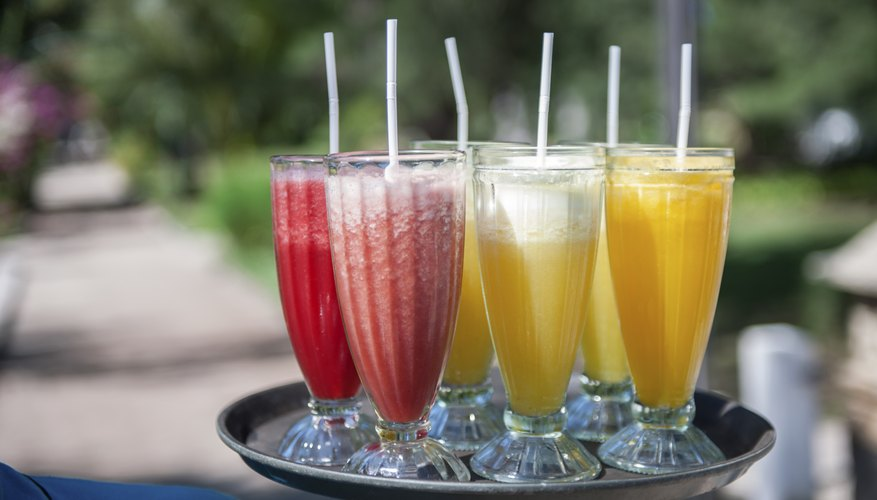 An assortment of fruity cocktails on a tray.