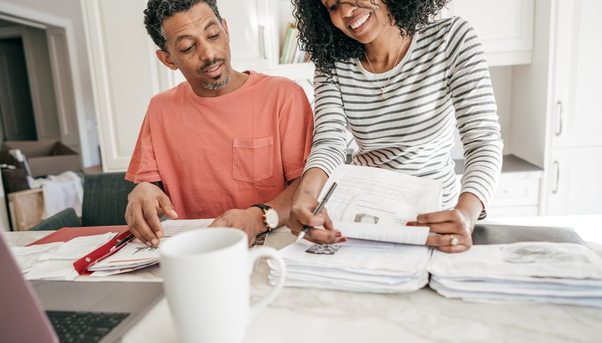 What Is the Difference Between Federal Withholding Tax & FICA?