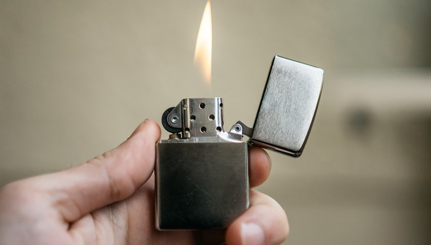 hand holding lighter with flame