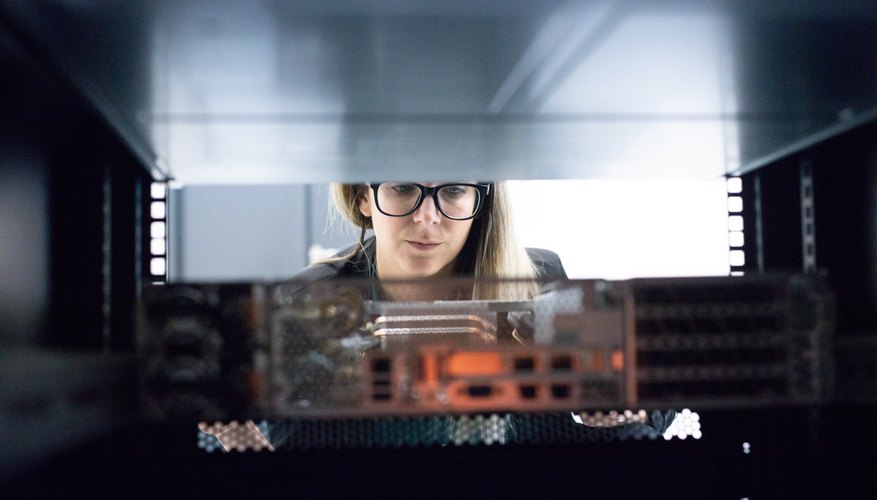 Female IT Technician Pulling Out Network Server for Service