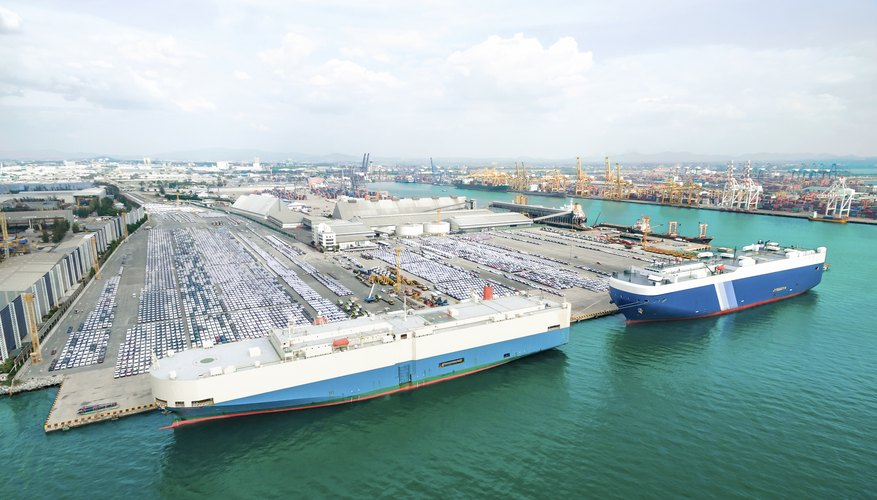 Cargo ship car park at shipping yard waiting for delivery by sea, thailand.
