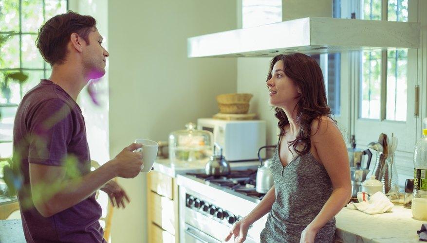 Couple having serious talk in kitchen.