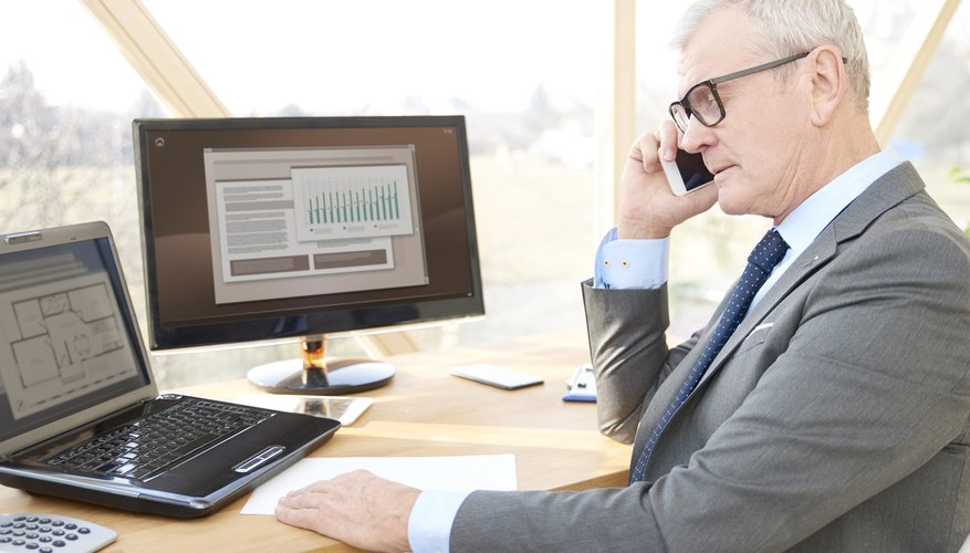 Senior professional man consulting with his client