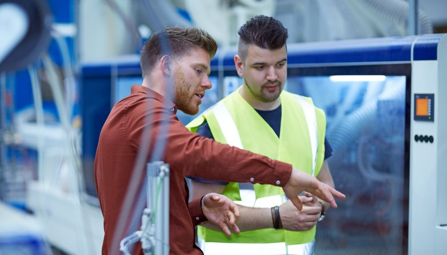 Manager giving work instructions to worker