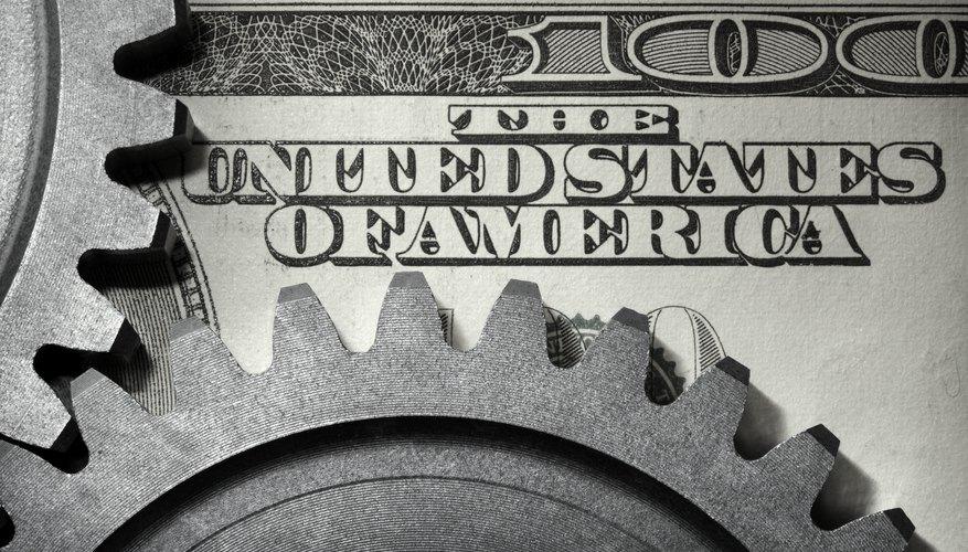 Interlocking gears on top of one hudred dollar bill