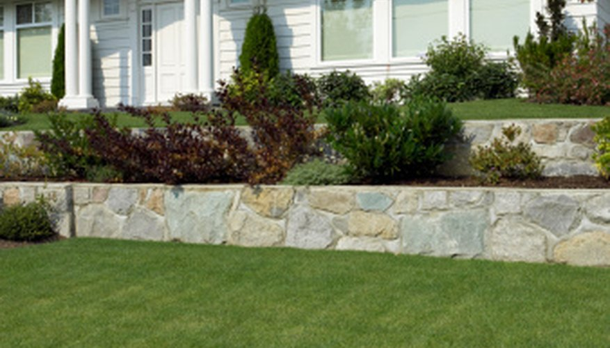 Landscaping a retaining wall can add value and beauty.