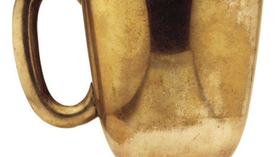 Drinking cup made of brass.