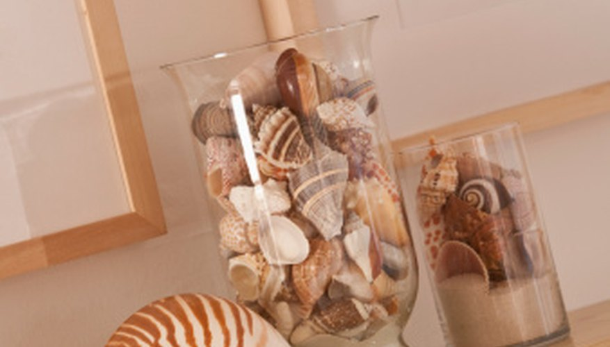 Fill a glass container with seashells for a dramatic display.